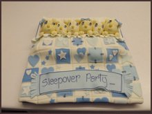 Blue and white cake with yellow rabbits on top