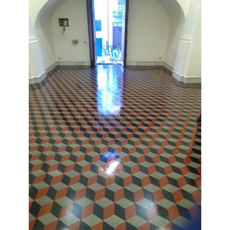 un pavimento in piastrelle di color marrone e nero con disegni a cubi
