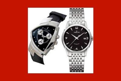 un orologio con cinturino d'acciaio e uno con cinturino di pelle