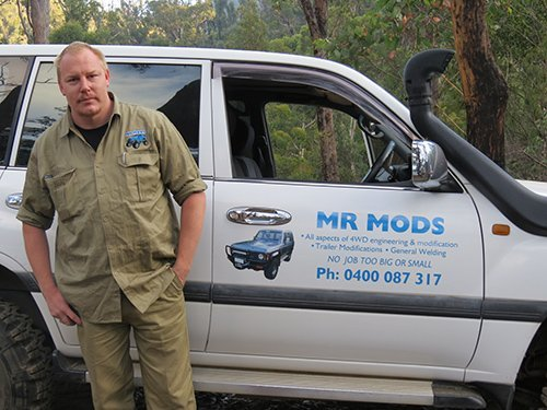 Professional standing next to the Mr Mods branded car