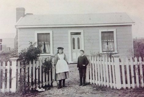 View of kids standing outside their houses