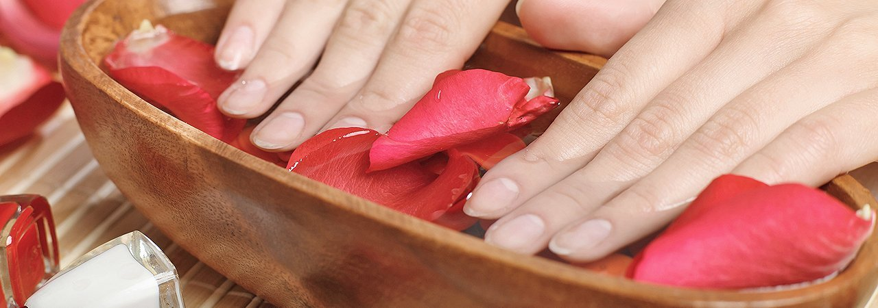 hands in rose water for cleansing