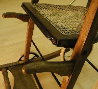 Seat of Victorian folding chair after restoration