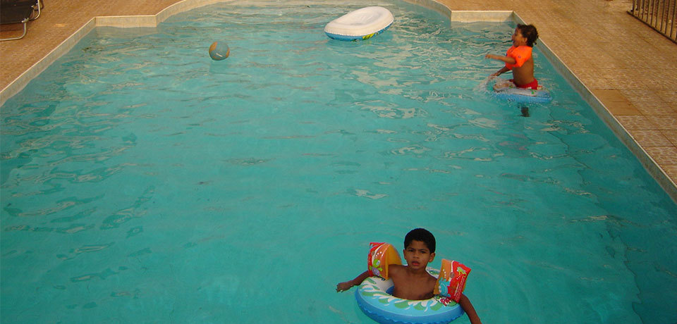 child playing in the pool