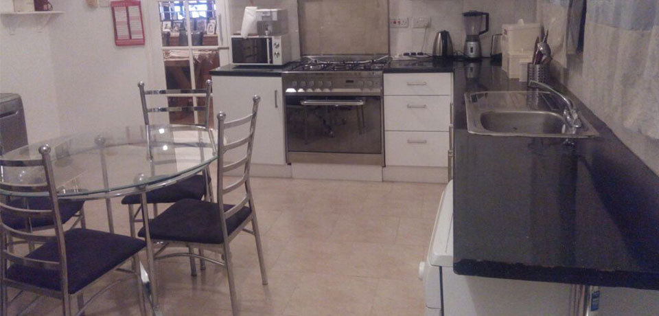 state of the art kitchen equipped with modern appliances