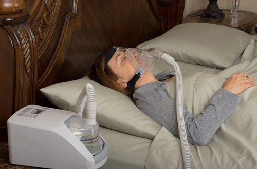 A woman using a sleep apnea appliance in Strongsville, OH