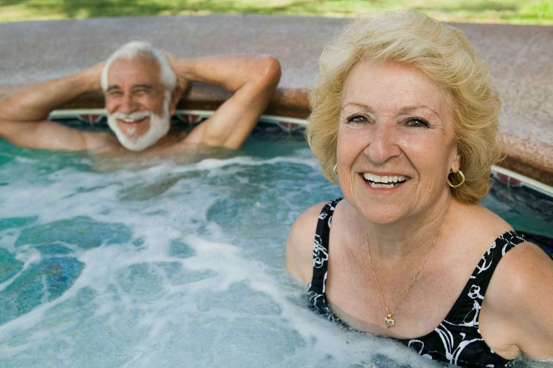mature couple in hot tub