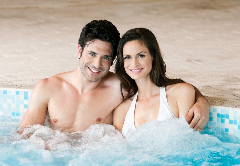 Couple enjoying spa after hot tub services in Perth
