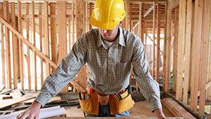 Professional builder in Platteville working inside a wooden house