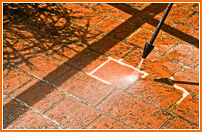 Patio area being jet washed