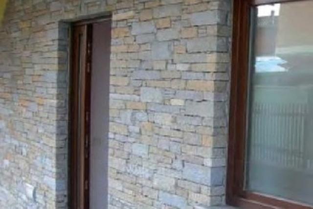Clad wall tile house entrance