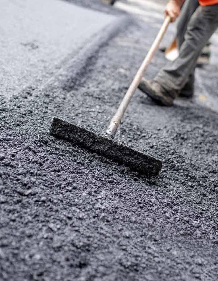 active asphalt worker work on the road construction