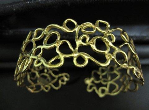 grande bracciale in oro giallo