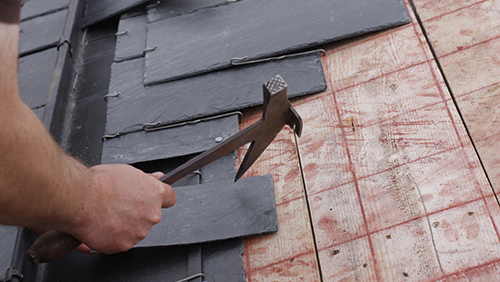 Roofing being done by professional on a client site