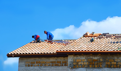 Qualified professional working on the roof installation