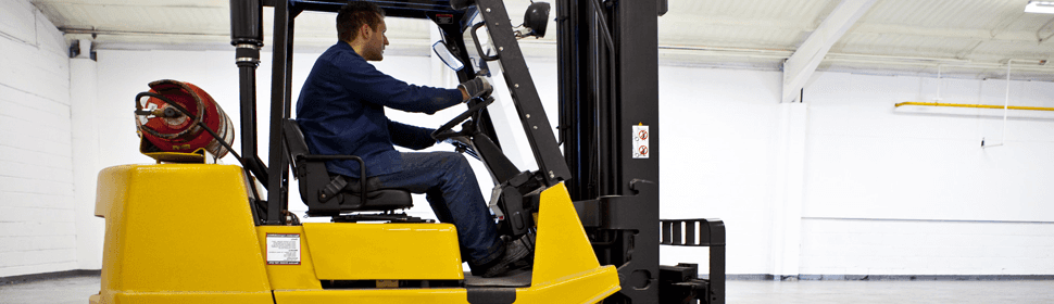 man driving forklift truck as part of training
