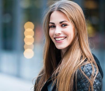 girl with full set of dentures