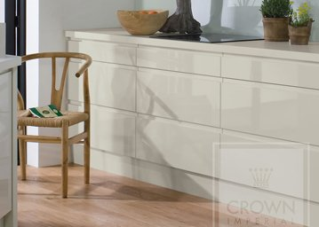 Pineto kitchen detail with wood floor and rafia seat chair against cream cupboards