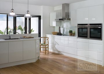 Oyster and white pineto kitchen with wood flooring