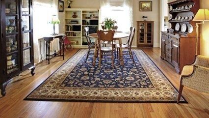 A dining set sat upon a rug