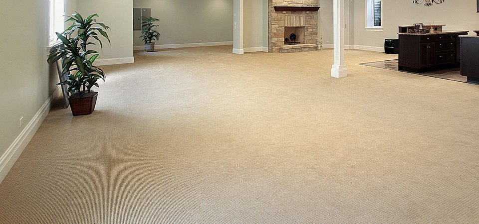 A large room filled with a cream coloured carpet