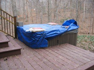 If this is what it takes to keep your hot tub cover from flying away in the wind you really need a SpaCap