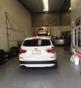 white suv in the shop