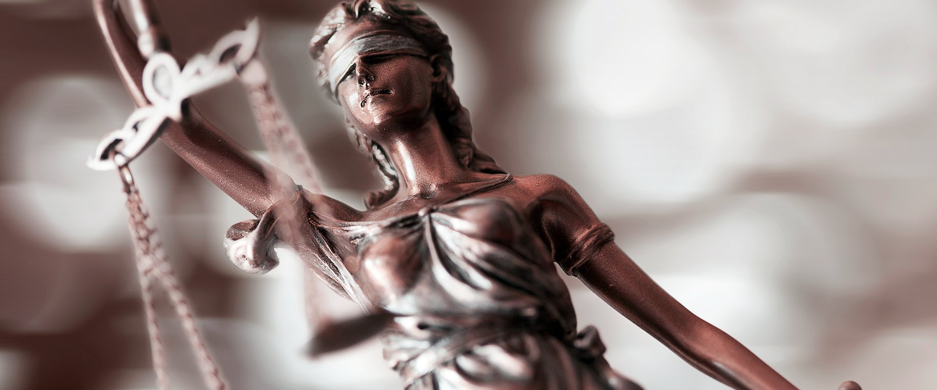 scales of justice held by lady justice