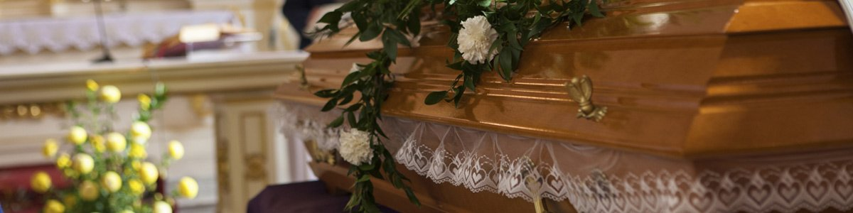 divinity funerals flowers on a coffin