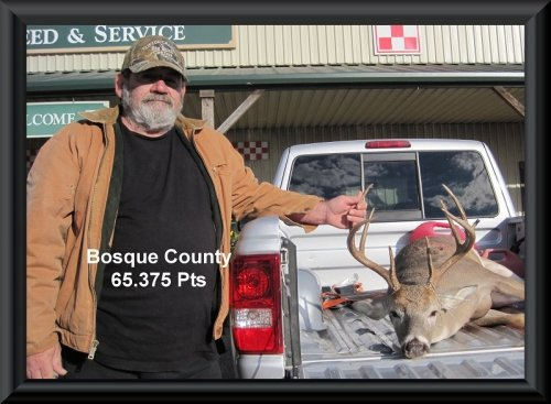 Contestant with the buck at big buck contest 2014 in Clifton, TX