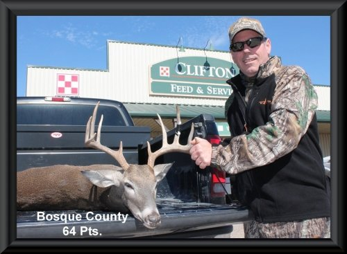 Contestant with the buck at the big buck contest 2014 in Clifton, TX