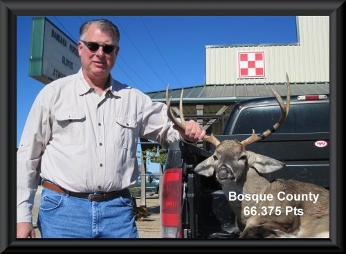 Constant with his buck at the the big buck contest 2014 in Clifton, TX