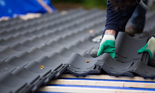 New roofing being installed by expert in Webster, NY