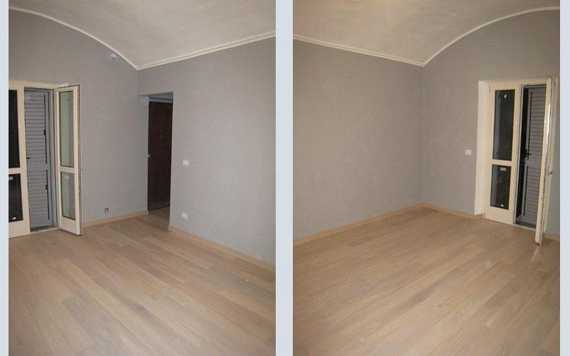 due diverse angolazioni di una stanza con pavimento in parquet