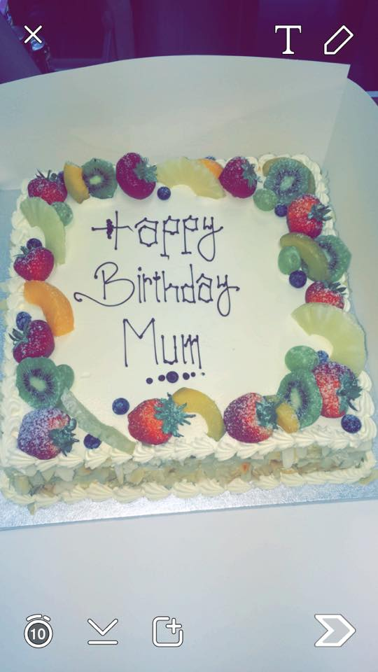 cut kiwi and berry on cake