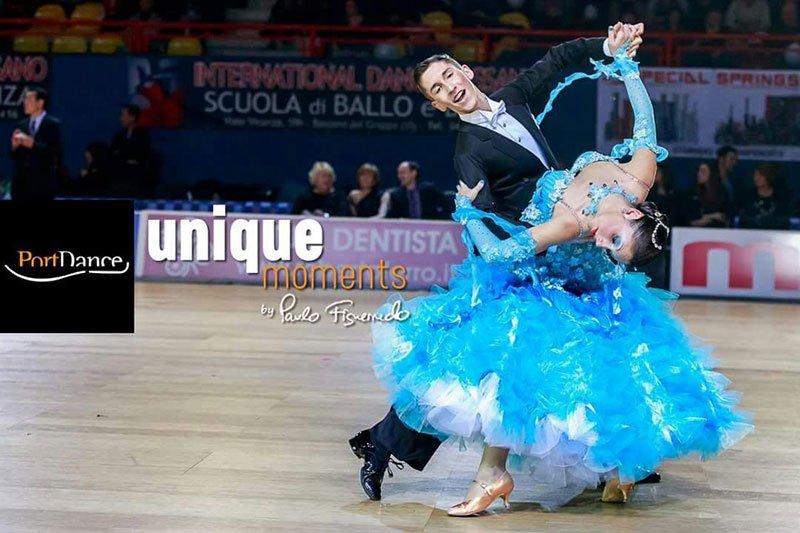 una coppia di ballerini che balla e la scritta unique