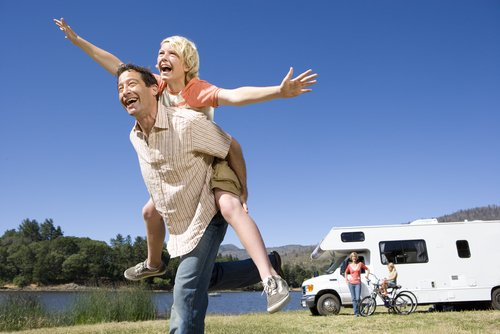Happy family having a good time with motor home