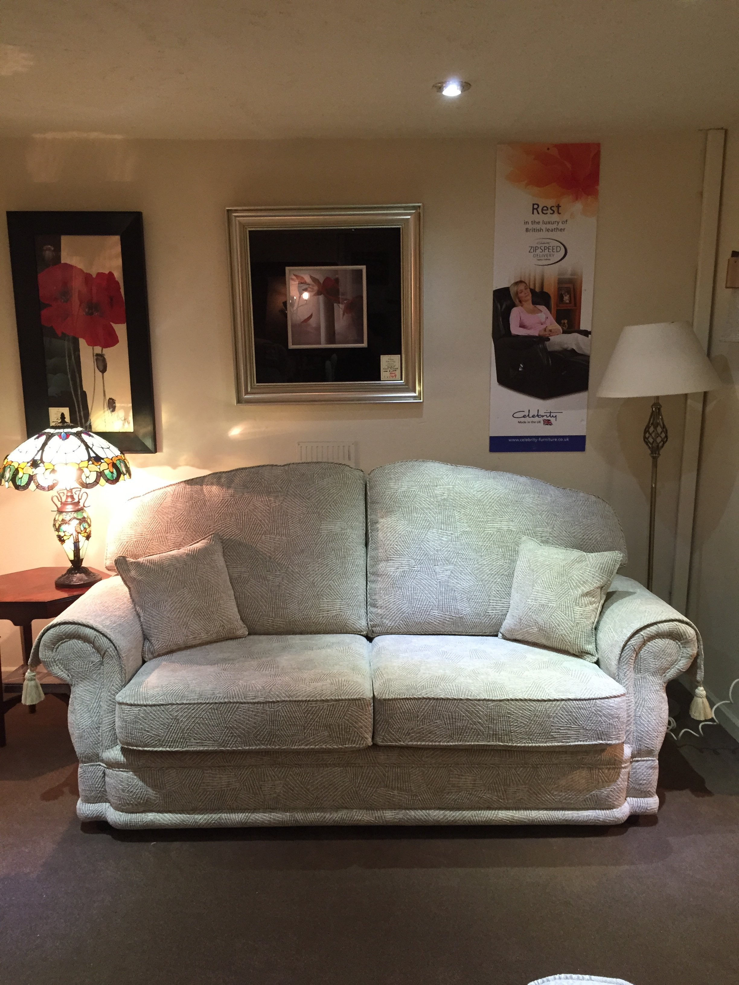 Cream two-seater sofa