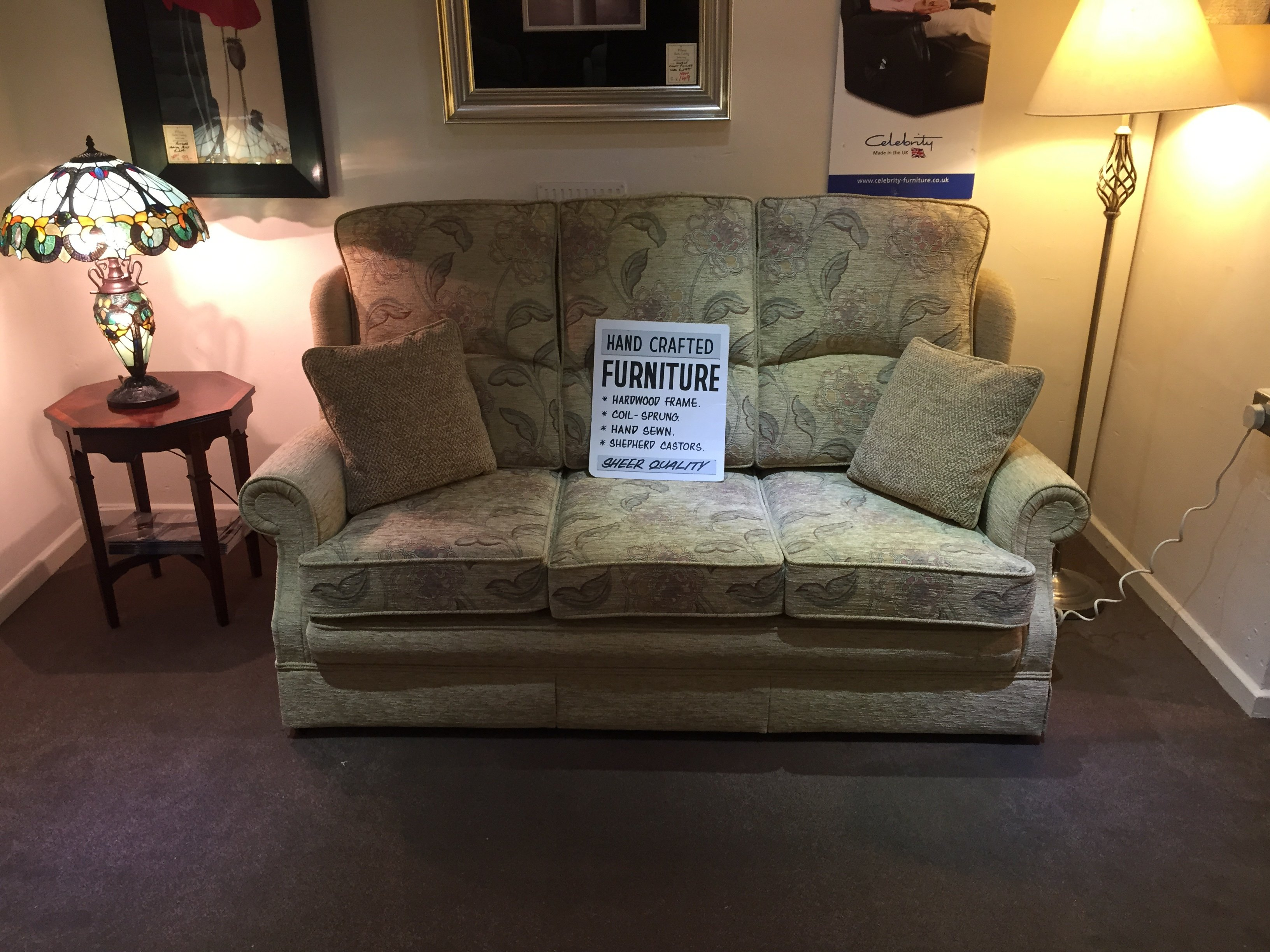Black and white display sign on a sofa