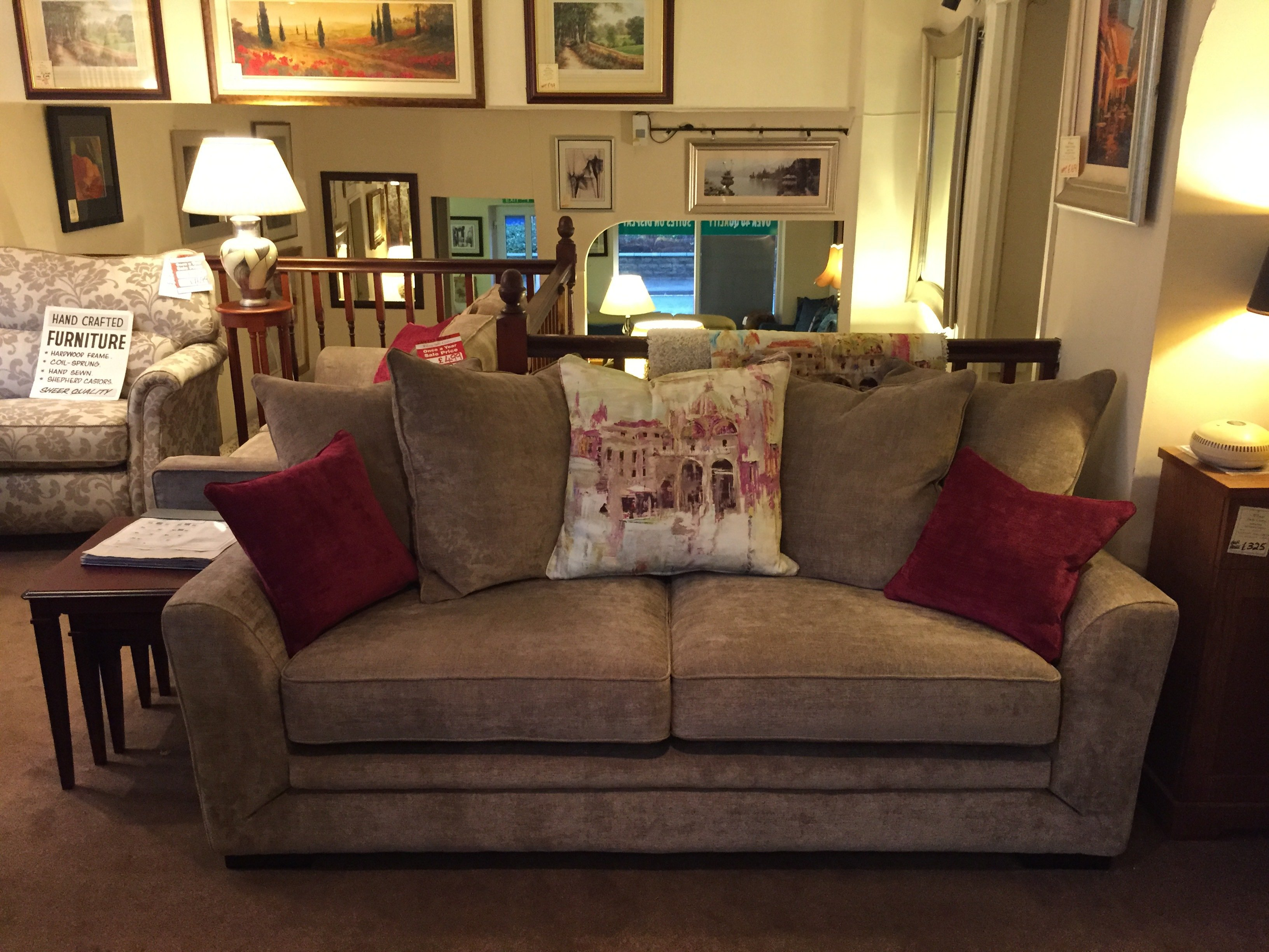 Brown sofa with contrasting scatter cushions