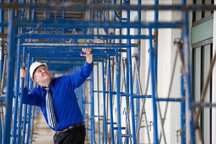Worker checking scaffolding in Hamilton
