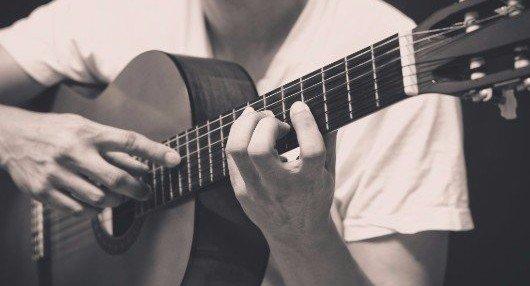man strumming the guitar