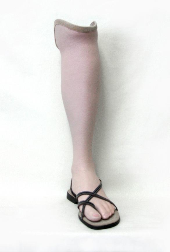 Below knee endoskeletal prosthesis with lifelike, hand painted