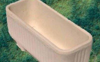 un vaso in cemento beige