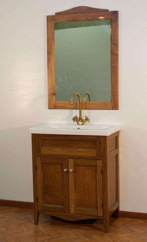 un armadio in legno con Sood lo smalto e, soprattutto, un lavandino e uno specchio