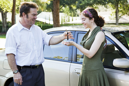 trained instructors hand woman a car key Rochester, NY