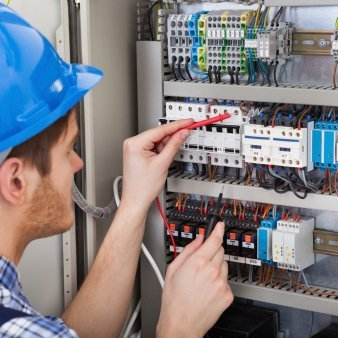 man fixing high voltage board