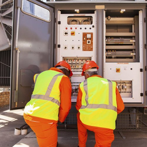 workers fixing transformer