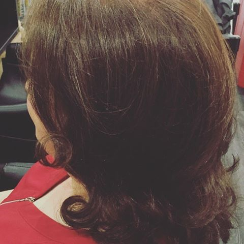 brown medium length hair with curled ends