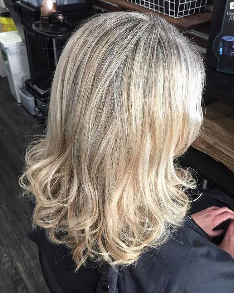blonde hair with curled ends